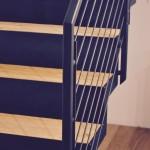 Dettaglio scala in legno e ferro